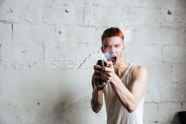 Férfi áll padló benzin spray fotó Stock fotó © deandrobot