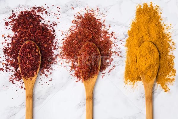 Assortiment coloré épices bois haut Photo stock © deandrobot