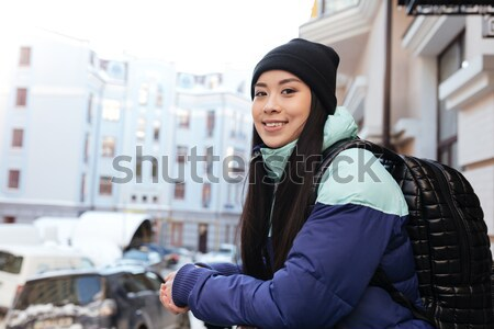 Happy Asian woman in warm clothes Stock photo © deandrobot
