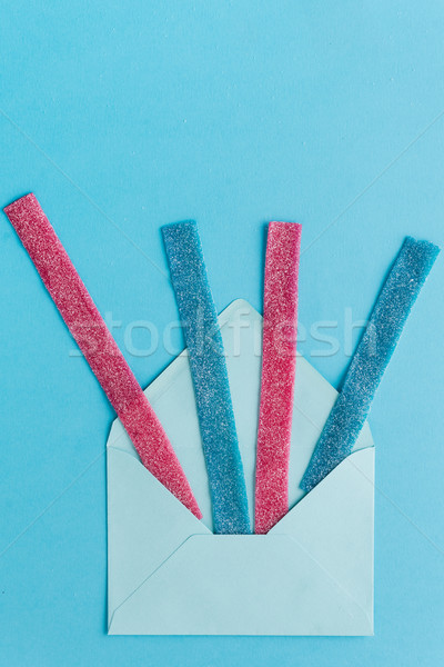 Sweet gummy sticks with blueberry and raspberry flavor Stock photo © deandrobot