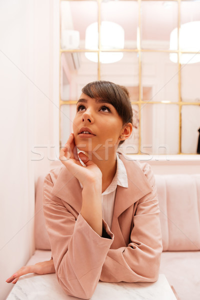 Dreaming woman in cafe Stock photo © deandrobot