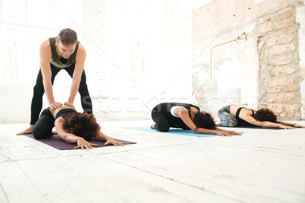 Group of young women doing stretching Stock photo © deandrobot