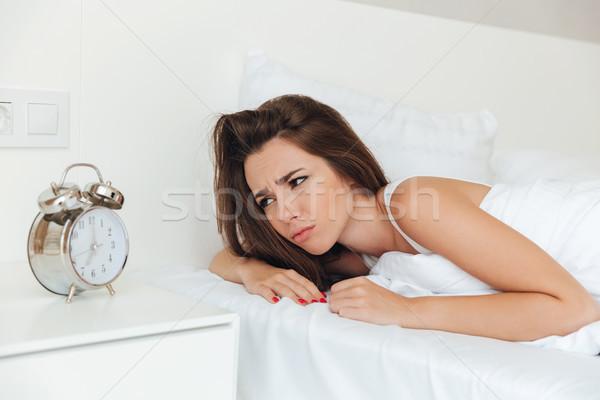 üzgün uykulu kadın yatak sabah Stok fotoğraf © deandrobot