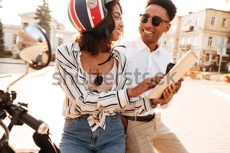 Young african couple in moto helmets Stock photo © deandrobot