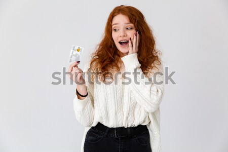 Portrait of a n amused happy asian woman pointing finger Stock photo © deandrobot