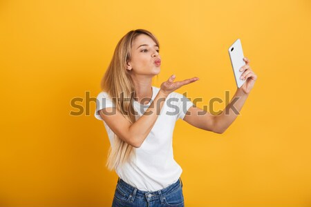 Cheerful pregnant woman drinking juice. Eyes closed. Stock photo © deandrobot