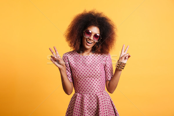 Portrait of a funny afro american woman in retro style Stock photo © deandrobot