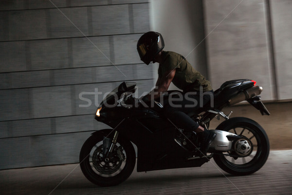 Portrait of a young afro american man in helmet Stock photo © deandrobot