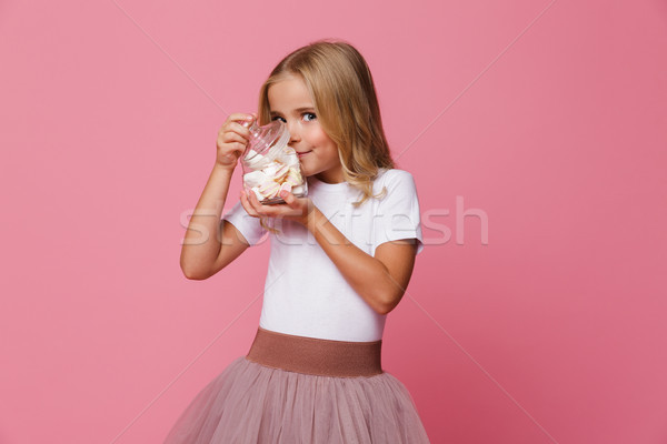 Portrait of a smiling little girl smelling marshmallow Stock photo © deandrobot