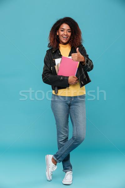 Imagem feliz africano mulher jaqueta de couro Foto stock © deandrobot