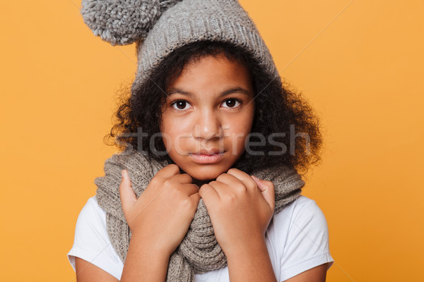 Close up portrait of a frozen afro american girl Stock photo © deandrobot