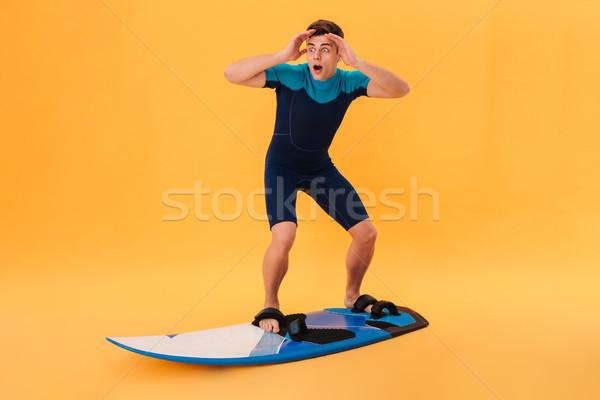 фотография Surfer доска для серфинга подобно волна Сток-фото © deandrobot