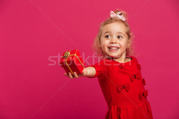 Image of Smiling young blonde girl in red dress Stock photo © deandrobot