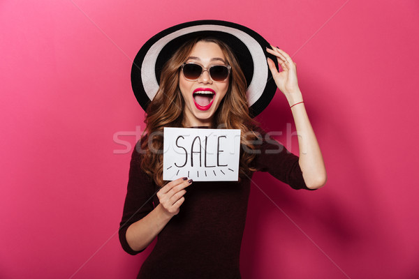 Portrait of an excited pretty girl wearing hat Stock photo © deandrobot