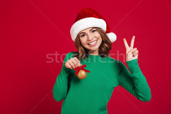 Lady wearing christmas santa hat Stock photo © deandrobot