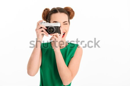 Image closeup of two redhead women 20s holding and photopraphing Stock photo © deandrobot