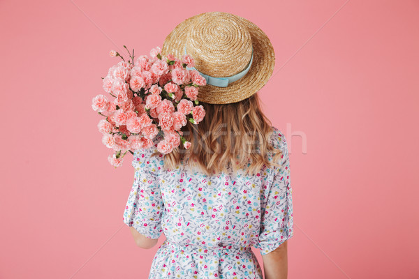 Back view portrait of a young woman in summer dress Stock photo © deandrobot