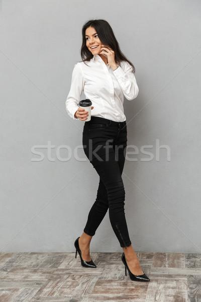 Teljes alakos kép csinos üzletasszony hivatalos visel Stock fotó © deandrobot