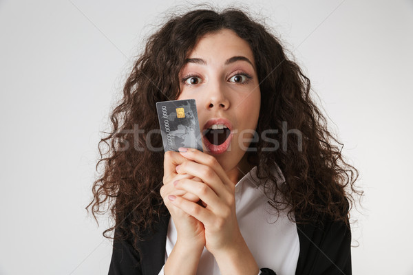 Excited shocked young business woman with credit card Stock photo © deandrobot