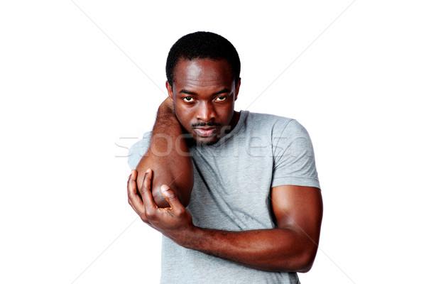 Portret afrikaanse man elleboog witte Stockfoto © deandrobot