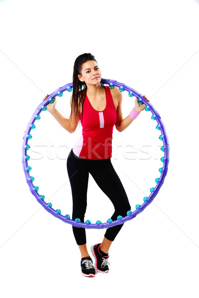 Young happy sport woman holding a massage hoop over white background Stock photo © deandrobot