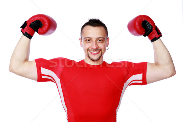 Cheerful boxer man winner raising arms over white background Stock photo © deandrobot