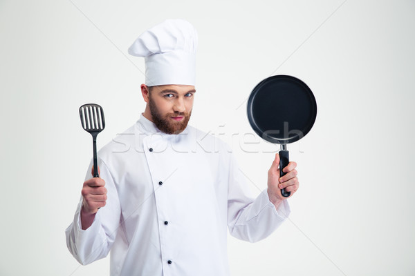 Male chef cook holding pan and spoon  Stock photo © deandrobot