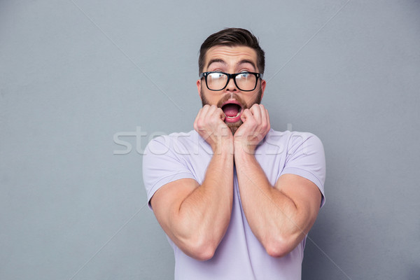 Portrait of a scared man looking at camera Stock photo © deandrobot