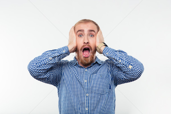 Portrait of a scared man screaming Stock photo © deandrobot