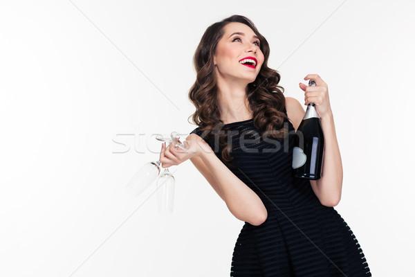 Beztroski kobieta butelki szampana dwa Zdjęcia stock © deandrobot