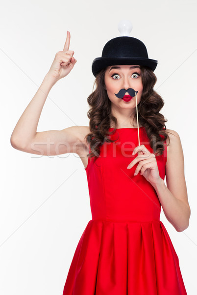 Playful woman having fun with moustache props  Stock photo © deandrobot