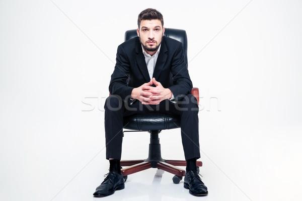 красивый молодые бизнесмен борода сидят черный Сток-фото © deandrobot