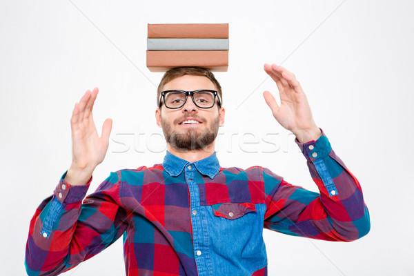 Szczęśliwy zabawny człowiek okulary książek głowie Zdjęcia stock © deandrobot