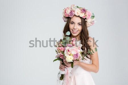 Aranyos fiatal nő koszorú virágcsokor virágok portré Stock fotó © deandrobot
