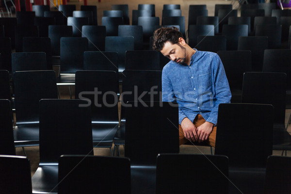 Man sleeping in conference hall Stock photo © deandrobot