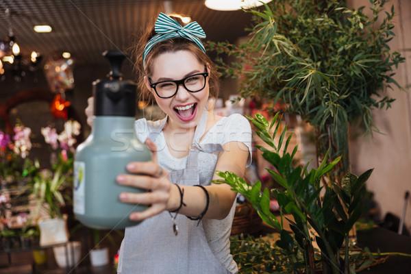 Foto stock: Mujer · florista · senalando · agua · juguetón · atractivo