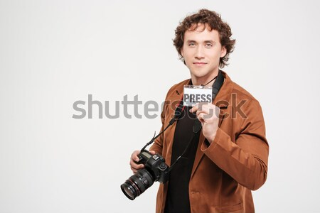 Male reporter holding card with the word press Stock photo © deandrobot
