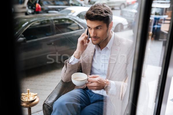 ビジネスマン 話し 電話 コーヒーショップ 魅力的な ハンサム ストックフォト © deandrobot