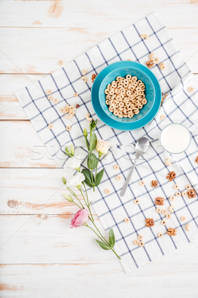 Breakfast bowl with cereal and flowers Stock photo © deandrobot