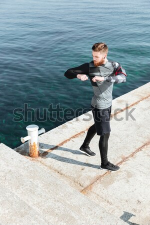 Runner drink water in harbor Stock photo © deandrobot