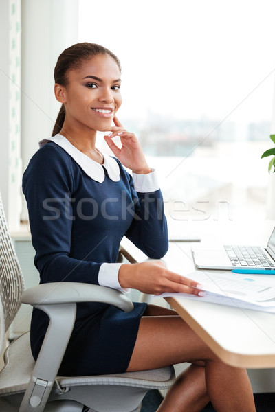 Stock photo: Vertical image of young african business woman on armchair