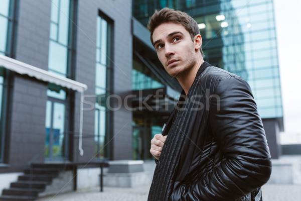 Serious Business man standing sideways Stock photo © deandrobot
