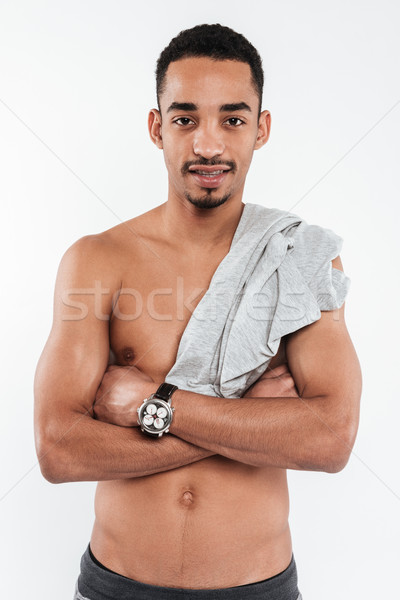 Handsome african man posing over white background Stock photo © deandrobot