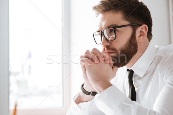 Komoly fiatal üzletember néz számítógép kép Stock fotó © deandrobot