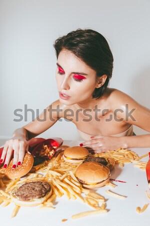 Sexy заманчивый женщину сидят таблице картофель фри Сток-фото © deandrobot