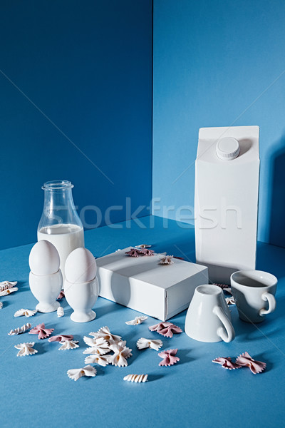 Milk bottle , two blank boxes, white coffee cups and pasta Stock photo © deandrobot