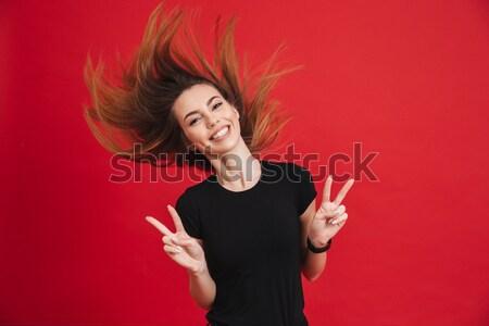 Young beautiful woman with headphones dancing Stock photo © deandrobot