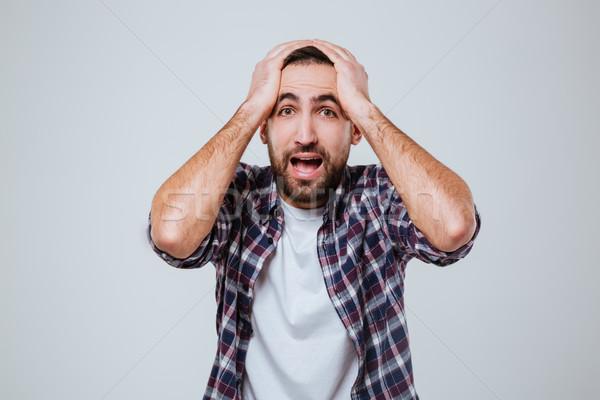 Overwhelmed bearded man in shirt Stock photo © deandrobot