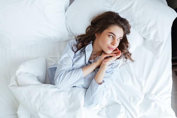 Młodych brunetka kobieta piżama bed Zdjęcia stock © deandrobot