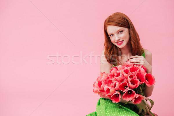Fiatal csinos nő tart virágcsokor virágok csinos Stock fotó © deandrobot